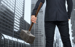 Determined businessman with hammer Stock Images
