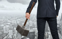 Determined businessman with hammer Stock Photo