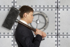 Determined businessman with hammer in hands Stock Photography
