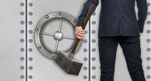 Determined businessman with hammer in hands Stock Photo
