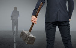Determined businessman with hammer Stock Image