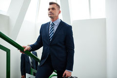 Determined businessman in office building Stock Photo