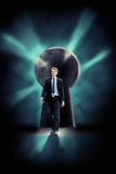 Determined Businessman Walking Through Keyhole Shaped Door royalty free stock photography