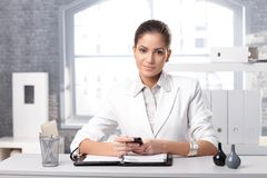 Determined businesswoman at desk Stock Photography