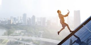 Up and up to the top. Mixed media. Determined businesswoman running up the skyscraper window. Mixed media royalty free stock photos