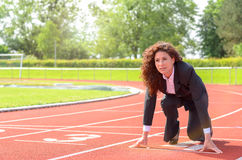 Determined businesswoman in the starting position Stock Photo