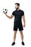 Determined challenging confident soccer player looking at the ball. Full body length portrait isolated over white background stock photo