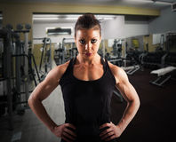 Determined coach. Woman with determined expression in a gym Stock Photography