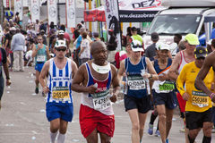 Determined Competitors Competing in Comrades Ultra Marathon Royalty Free Stock Images