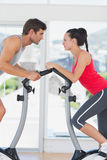 Determined couple working out at spinning class Stock Photo