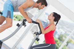 Determined couple working out at spinning class Royalty Free Stock Photo