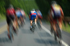 Determined Cyclist. Cyclist taking the lead Royalty Free Stock Photos