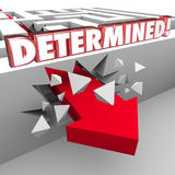 Determined 3d Red Words on Maze Wall Arrow Crashing Through. Determined 3d words on wall with arrow crashing through to show commitment to reaching an objective Royalty Free Stock Images