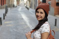 Determined ethnic woman smiling on the street.  royalty free stock image