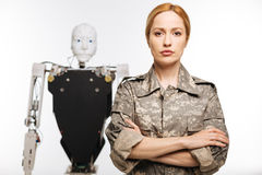 Determined experienced officer helping create new type of a weapon. Combat expert. Ambitious trained resolute woman using science for developing military royalty free stock photos