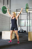 Determined Female Athlete Lifting Weights In Health Club Stock Photo