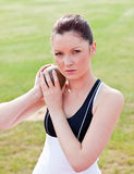 Determined female athlete ready to throw weight Royalty Free Stock Photography