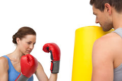 Determined female boxer focused on her training Royalty Free Stock Image