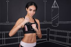 Determined female boxer involved in training Stock Photography