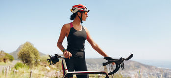 Determined female cyclist looking away Stock Photography