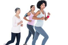 Determined female friends jogging Stock Images