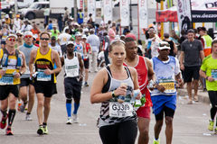 Determined Female Runner in Comrades Ultra Marathon Royalty Free Stock Photo