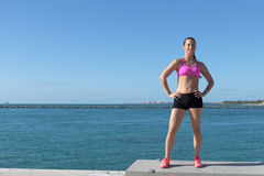 Determined, fit hispanic woman by the ocean Stock Images