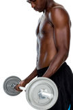 Determined fit shirtless young man lifting barbell Royalty Free Stock Photo