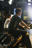 Asian man exercise bikes at the gym Stock Photos