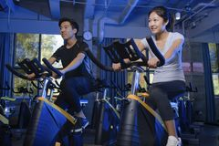 Asian man exercise bikes at the gym Royalty Free Stock Photo