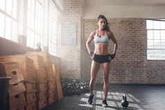 Determined fitness woman walking in the crossfit gym stock photos