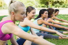Determined friends stretching at park Royalty Free Stock Photo