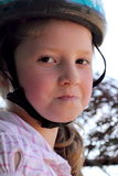 Determined girl wearing helmet. A closeup of a determined preteen girl wearing a helmet. Shallow depth of field Royalty Free Stock Images