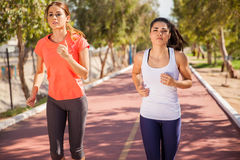 Determined girls running royalty free stock images