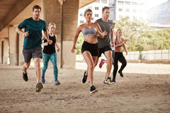 Determined group of young people running in city Stock Photos