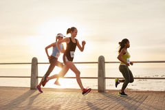 Determined group of young people running in city Royalty Free Stock Images