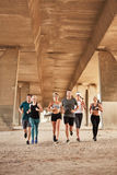 Determined group of young people running in city Royalty Free Stock Photography