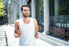 Determined handsome athlete jogging Royalty Free Stock Image