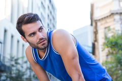Determined handsome athlete looking away Royalty Free Stock Photos