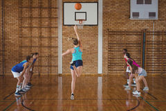 Determined high school kids playing basketball royalty free stock photo