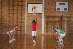 Determined high school kids playing basketball stock images