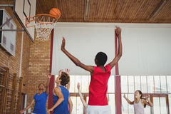 Determined high school kids playing basketball stock photography