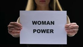 Determined lady holding woman power sign, social standards change, freedom. Stock footage stock footage