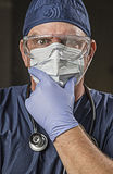 Determined Looking Doctor or Nurse with Protective Wear and Stet Royalty Free Stock Photo