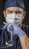 Determined Looking Doctor or Nurse with Protective Wear and Stet Stock Photo