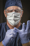 Determined Looking Doctor or Nurse with Protective Wear and Stet Royalty Free Stock Photography