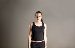 Determined looking youn fitness girl. Royalty Free Stock Photography