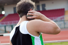 Determined male athlete preparing to throw weight. Concentrated male athlete preparing to throw weight in a stadium royalty free stock photo