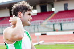 Determined male athlete preparing to throw weight Stock Photo