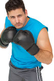 Determined male boxer focused on his training Stock Photo